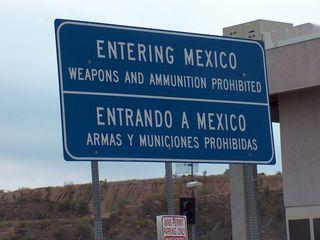 18) Guns Sign at Border